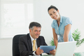 Business man and woman smiling together in an office while working - PhotoDune Item for Sale
