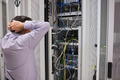 Technician feeling frustrated over server maintenance in data center - PhotoDune Item for Sale