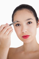 Woman filling in eyebrows with a brush - PhotoDune Item for Sale