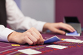 Dealer dealing cards at table of a casino - PhotoDune Item for Sale