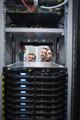 Tehnicians looking into servers in data center