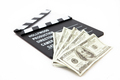 Film slate and money lying against white background - PhotoDune Item for Sale