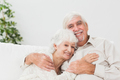 Old couple hugging on couch - PhotoDune Item for Sale