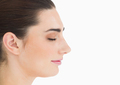 Side view of natural woman having eyes closed - PhotoDune Item for Sale