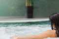 Brunette woman relaxing in jacuzzi - PhotoDune Item for Sale