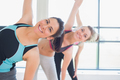 Happy women stretching in fitness studio of gym - PhotoDune Item for Sale