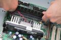 Closeup of computer engineer repairing cpu