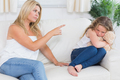 Angry mother scolding daughter clutchin teddy bear in living room - PhotoDune Item for Sale