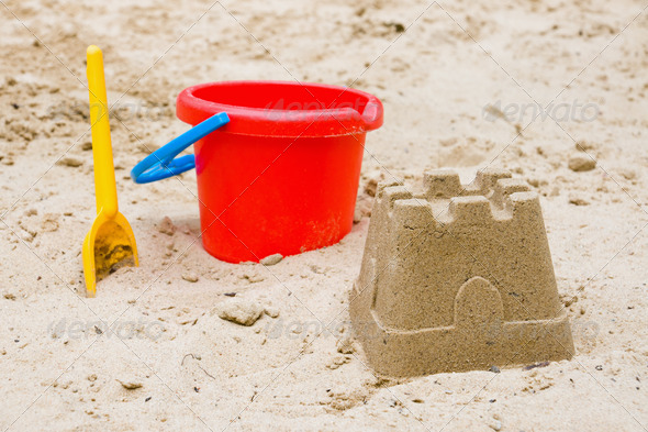 Sandcastle with bucket and shovel - Stock Photo - Images