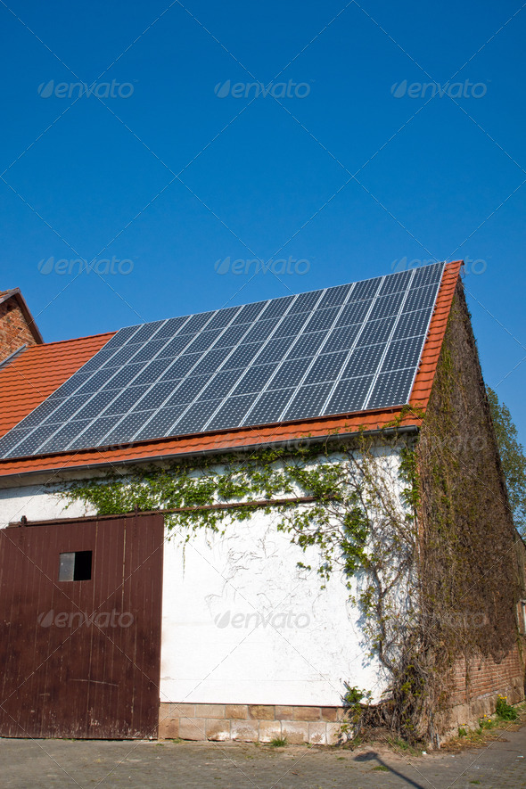 Old barn with solar cells - Stock Photo - Images