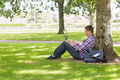 Young student using laptop outside on college campus - PhotoDune Item for Sale