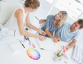 Group of artists working on designs in a bright office - PhotoDune Item for Sale