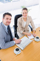 Smartly dressed young man and woman in a business meeting at office desk - PhotoDune Item for Sale