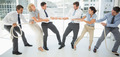 Full length of a group of business people playing tug of war in office - PhotoDune Item for Sale
