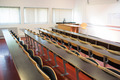 View of empty wooden seats with tables in a lecture hall - PhotoDune Item for Sale