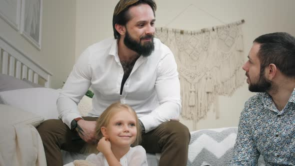 Same Sex Male Couple At Home Fathers With Daughter In Bedroom By Azhorov