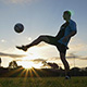 Soccer (Football) Player Juggles a Ball at Sunset - VideoHive Item for Sale