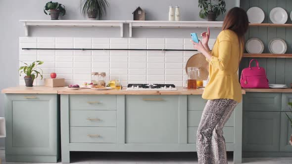 Late Lady Running Through Kitchen in Morning To Work