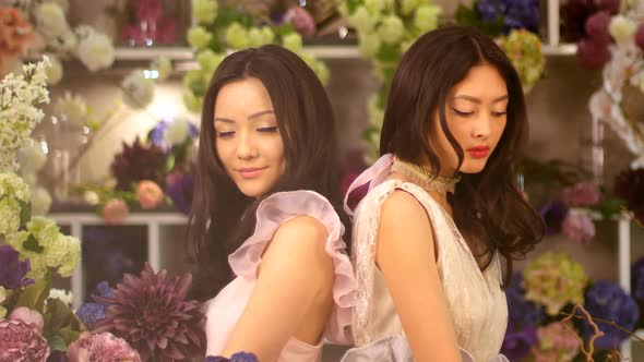 VideoHive Florists Asian Women Happy Working in Flower Store 20022663
