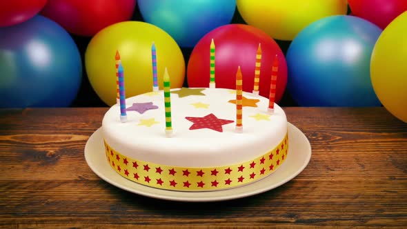 Birthday Cake On Table With Balloons Stock Footage