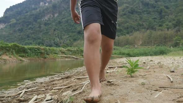 Legs Of  Poor Boy Walking