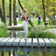 Blonde woman running across bridge in green park - VideoHive Item for Sale
