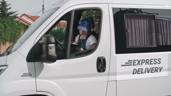 Young Female Delivery Van Driver by Pressmaster | VideoHive