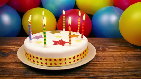 Birthday Cake With Lit Candles On Table Stock Footage