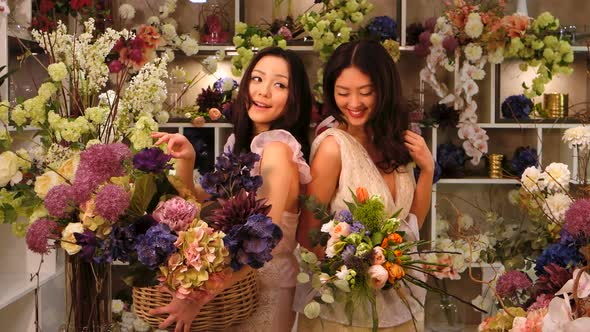 VideoHive Florists Asian Women Happy Working in Flower Store 20022664