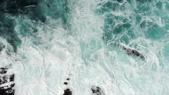 Fierce Stormy Waves, Covered with Foam, Striking the Rocky Coast with Great Power