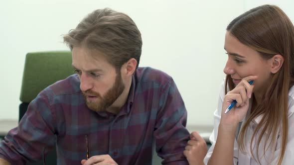 Man and Woman Work in Comfortable Modern Office Discussing