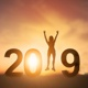 Silhouette Young Woman Jumping To 2019 New Year - VideoHive Item for Sale