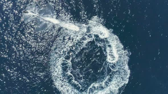 Aerial Top Down View Shot Of A Person Jet Skiing In Circles By